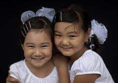 Two girls smiling, Kyrgyzstan by Eric Lafforgue, via Flickr