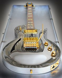 Chrome Les Paul with gold hardware.nice Not so crazy about the gold but the guitar is really cool Unique Guitars, Custom Guitars, Vintage Guitars, Guitar Art, Music Guitar, Cool Guitar, Pink Guitar, Guitar Chord, Guitar Tattoo