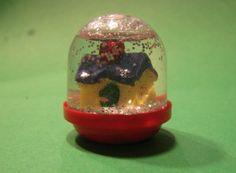 DIY snowglobe #tutorial  also make mini bottle snowglobe charms with mini bottles: http://www.ecrafty.com/c-517-mini-glass-bottles.aspx #ecrafty