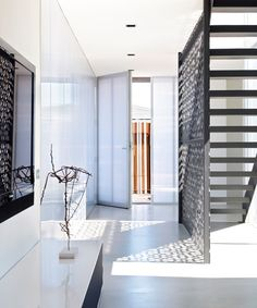 stair with decorative screen wall :: hear :: the full height / flush detailing