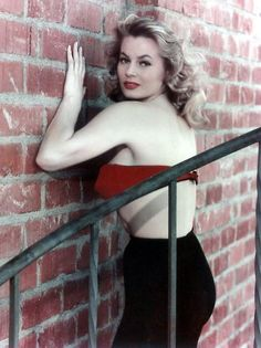 Anita Ekberg against the wall