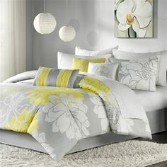 Lola is the perfect solution to an updated, modern print look. This comforter collection features an overscaled floral print design printed on 100% cotton fabric for a super soft hand feel. The reverse of the comforter is a soft white color that coordinates with the grey, white and yellow from the face of the comforter. The decorative pillows feature embroidery and piecing details.