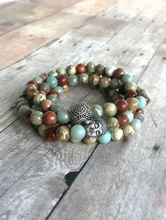 Multicolored 108 bead mediation mala for women or men. Sterling silver Buddha bead and Om bead