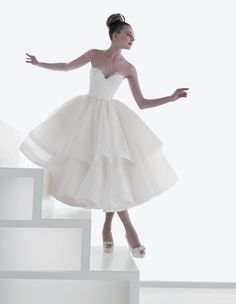 LOVE IT - Tea Length Dresses  http://bellethemagazine.blogspot.com/2011/09/wedding-trends-tea-length-bridal-gowns.html#.TwP8mDVrNM0