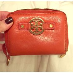 Used Tory Burch Wallet Keychain Gently used and in great condition. Zip around closure. 3x5 measurement. Orange leather  Tory Burch Bags Wallets