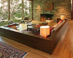 sunken living room seating. Maybe in  concrete                                                                                                                                                                                 More