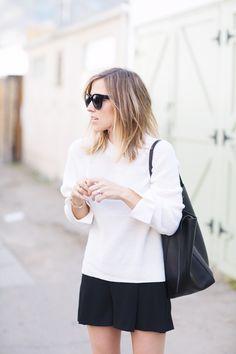 White Sweater Black Shorts