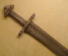 Viking sword (9th/10th century CE) - pattern-welded iron inlaid with silver wire - Metropolitan Museum of Art, NYC