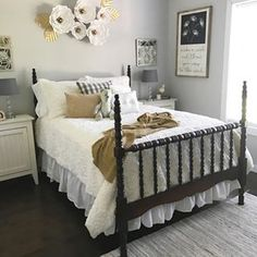 """I think I want to stay in my pretty room for the whole day! And look at the sunshine streaming in.  I am beyond obsessed with my """"new"""" Jenny Lind bed from my father-in-law. This was Lance's great grandparents. While I loved my old door headboard, this is stunning in here! Except I think I need to move my flowers from @creationsbymayra down a smidge, what do y'all think? ❤️❤️  .  .  .  #vintage #bedroom #antique #decor #decorate #homedecor #farmhouse #shabbychic #mycountryho"""