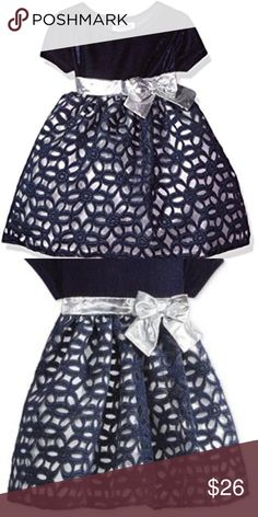 Blueberi Boulevard Floral Geometric Dress (NWT) Blueberi Boulevard Floral Geometric Dress  She'll be as pretty as a princess in this girls' Blueberi Boulevard bow and floral dress. In navy/silver.  PRODUCT FEATURES  Crewneck Short sleeves Silver-tone bow at waist Metallic floral overlay Plush bodice  FABRIC: Polyester, spandex, metallic, nylon  Condition: New Blueberi Boulevard Dresses Formal