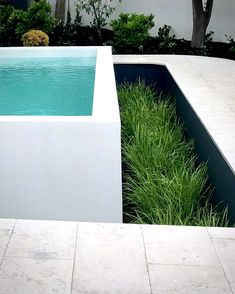 Raised White Pool - Fully tiled white pool with microcement render design by tr. - Raised White Pool – Fully tiled white pool with microcement render design by tristanpeirce Lands -