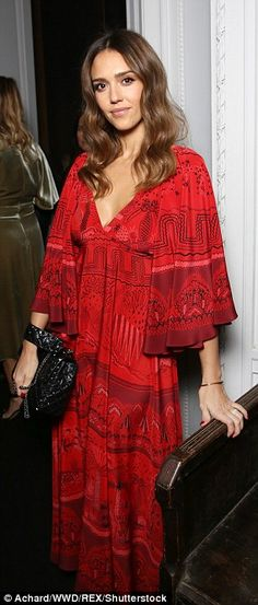 Elegant: Ever the natural beauty, she wore her brunette tresses slightly tousled...