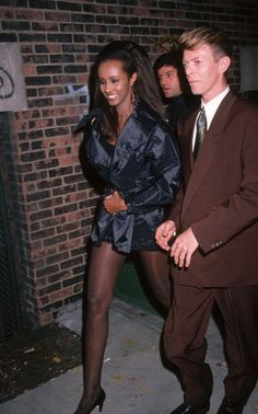 Iman and David Bowie during '7th On Sale' To Benefit AIDS Research November 29 1990 at 69th Regiment Armory in New York City New York United States