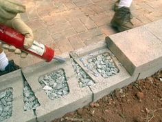 Add cap blocks to the top row of a block or stone retaining wall. You can add a layer of masonry adhesive to hold them in place, then back fill. Or you can backfill as you go, then add the cap. Either (Patio Step Retaining Wall) Retaining Wall Fence, Small Retaining Wall, Building A Retaining Wall, Landscaping Retaining Walls, Front Yard Landscaping, Concrete Block Retaining Wall, Retaining Blocks, Concrete Curbing, Concrete Wall