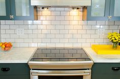 White subway tiles and teal kitchen cabinets in this unique kitchen design. #interiors #interiordesign #decor #kitchen www.porch.com
