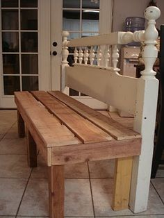 A headboard made into a bench.  I already have the headboard! I would paint the seat white to match.