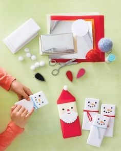 Santa and Snowmen Bars - Wrap a sweet treat in your own Santa or snowman wrapper. This is a great Christmas gift idea. Martha Stewart (again). Shes so festive!