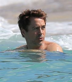 Robert Downey Jr. takes a swim in the ocean at St. Barts, December 29, 2013.