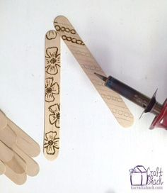wood burning craft stick bookmarks.... but for the bottle opener