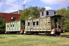 Old wooden work cabooses at Cleburne, TX...