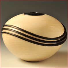 Three Wave Vessel in maple and walnut by John Beaver.