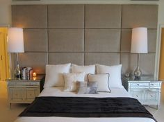 Full wall headboard, mirrored side tables...love the squares.