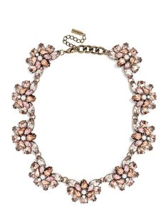 A gem-encrusted collar relies on a simple, flattering silhouette to make a statement--we love the femme pearl accents on the rose colorway.