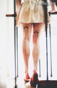Thigh bow tattoos