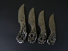 Knives made out of recycled bicycle chains.
