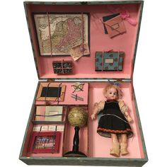 Up for sale is a rare and wonderful nice Armand Marseille doll in its original school setting presentation box. This is highly unusual as it has