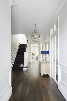 Tips for designing a Hamptons style home. Hamptons Style Homes, The Hamptons, Melbourne, Wood Floor Design, Greenhouse Interiors, Exterior Wall Light, Moving Furniture, Hallway Decorating