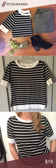 """Ann Taylor Loft Black Striped Sweater Tee What I love about AT is the quality and classic style over time! This is a medium weight short sleeve sweater that is easy to throw on with any jean, add booties and a cute bag and you're set! Cotton blend. Slightly off-white (oyster, not cream.) ▪️Black & ivory ▪️19"""" armpit to armpit flat across and 25"""" shoulder to hem length. ▪️The last photo shows some dark jean transfer on the inside of back bottom hem- does not show when on! LOFT Sweaters Crew…"""