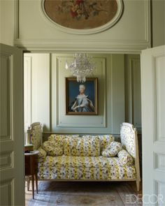 Double doors in a wood-panelled wall open into a small bedroom furnished with a French bed with cushions and cover in a floral striped fabric French Country Bedrooms, French Country House, French Cottage, Hermes Home, Interior And Exterior, Interior Design, Room Interior, Interior Ideas, Paris Design