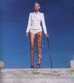 Nadja Auermann in leg brace by Helmut Newton for VOGUE