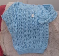 Cooler weather, so an #Aran jumper in a mixture of cable and lace. At £17.50 + £4.50 postage and handling, this sky blue acrylic / will mix jumper is machine washable and a size 26 inch / 66 cm chest.  Message me for further details or to order