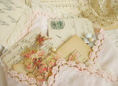 Shabby chic little linen envelope, probably made out of a vintage napkin or hankie, hols vintage mail.