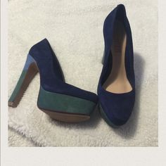 New in box, platform front, high heels These shoes are brand new and come in their box, leather sole, suede shoe, dark blue, platform is green and the heel is green and light blue. They are beautiful and can be dressed up or down depending on the occasion. Make me an offer. SCHUTZ Shoes Heels