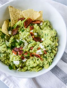 Bacon Goat Cheese Guacamole by @howsweeteats. Can't imagine how delicious this must be.