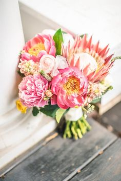 You can't go wrong with a coral charm peony and protea wedding bouquet for a home soiree in Virginia! | Amy Lynne Originals