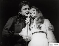 Johnny Cash singing with wife June Carter, circa mid-1970s.