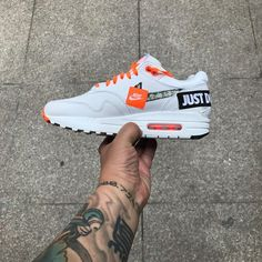 """Nike Sportswear has produced an edition of the Air Max 90 that is defined by """"Just Do It"""". The colorway for the drop is set in white leather with Nike orange accents. The sneaker is then covered by """"Just Do It"""" on the toe, heel and side panel. The sneaker release is upcoming. Stay with us for updates. A post shared"""
