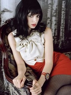 Krysten Ritter. Love the high waisted shorts with patterned tights.