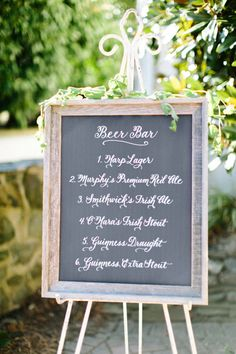 If your wedding's cocktail bar is totally beer-focused, don't let your guests frustrate the bartender by asking what brews you are serving (because the list is long). Instead, put up a stylized chalkboard beer sign to match your wedding's theme, listing each option out.