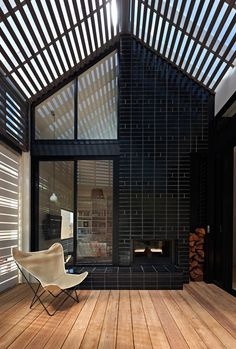 An interesting brick pattern and a double sided fireplace makes a feature of the covered deck area in House Reduction