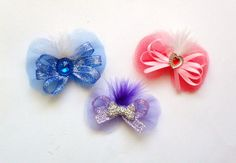 What a great trio of dog bows Or Pick Just One Made with tulle fabric, feathers, satin ribbon, metallic ribbon and rhinestones you can have these on barrettes or two grooming bands sewn on the back Dog Hair Bows, Dog Bows, Valentines Day Dog, Tulle Fabric, Feather, Ribbon, Sewing, Metal, Dogs