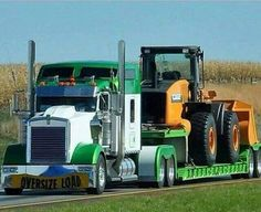 Custom Kenworth with a John Deere loader on its matching lowboy.