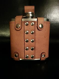 Laser Cut and Handmade Leather Flask Holder. $80.00, via Etsy.