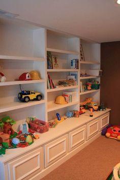 Basement idea minus the toys. Use to display Scott's trophies, pictures, Alabama memorabilia, etc.