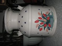 Painted milk can.