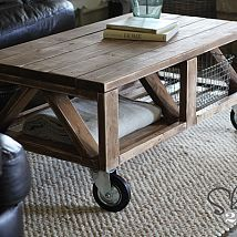 DIY Truss Coffee Table I am loving my latest furniture build! I love the great pieces you can build with 2x4's. I teamed up with Ana White to desi...